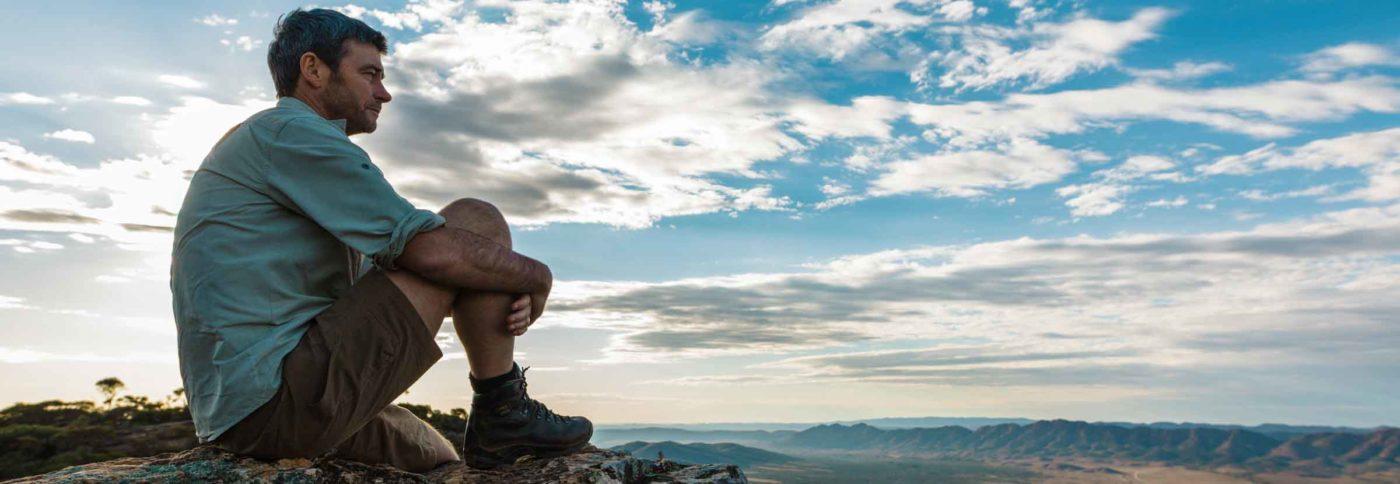 Hiker resting on a Flinders Ranges walk